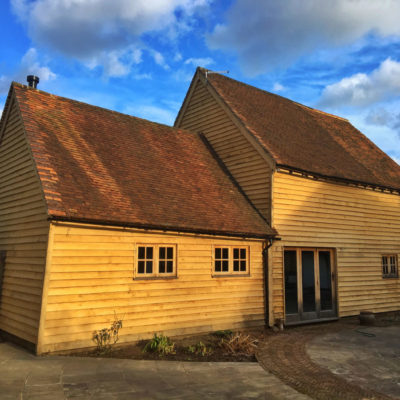 17th century barn conversion with new feather edged oak cladding, corner stops and joinery cheeks, Dunsfold