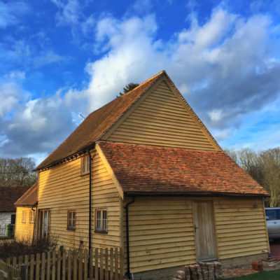 17th century barn conversion with new feather edged oak cladding, corner stops and joinery cheeks