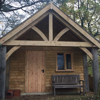 Outbuilding with oak truss Haslemere