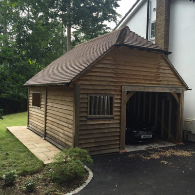Single bay garage with store room and mullion windows